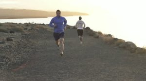 stock-footage-people-jogging-by-the-sea-super-slow-motion-shot-at-fps
